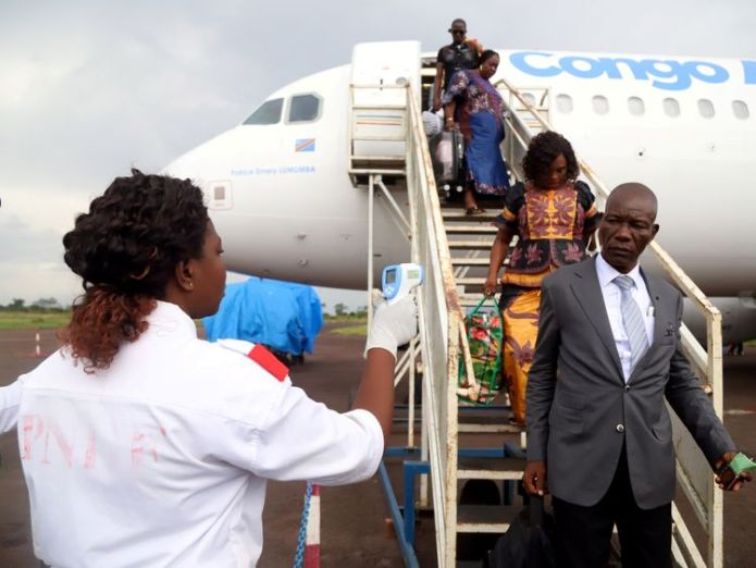 Congolese health workers check the temperature of passengers disembarking from a Congo Airways plane in Mbandaka, Democratic Republic of Congo May 19, 2018  WHO vows to fight new Ebola outbreak in DR Congo skynews mbandaka congo ebola 4377898