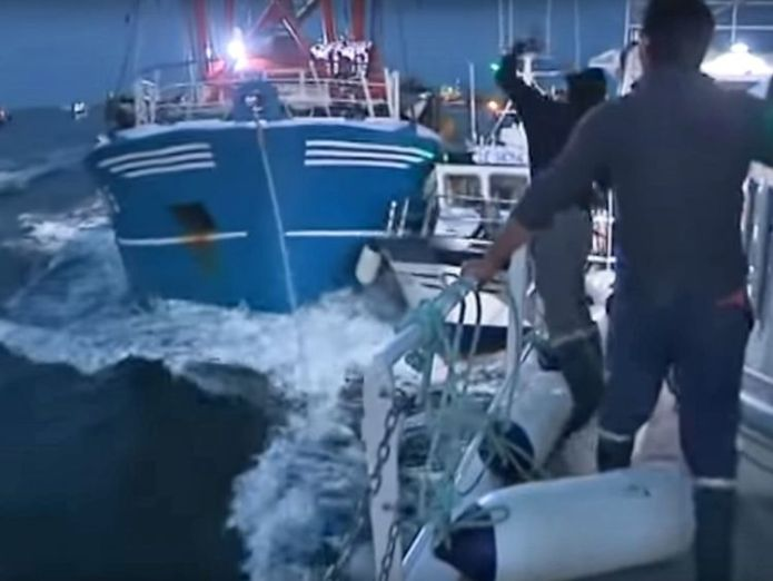 Pic: France 3 Normandie  May calls for 'amicable solution' to scallops row after French fishermen 'attack' skynews scallop fishermen french smoke bombs 4404389