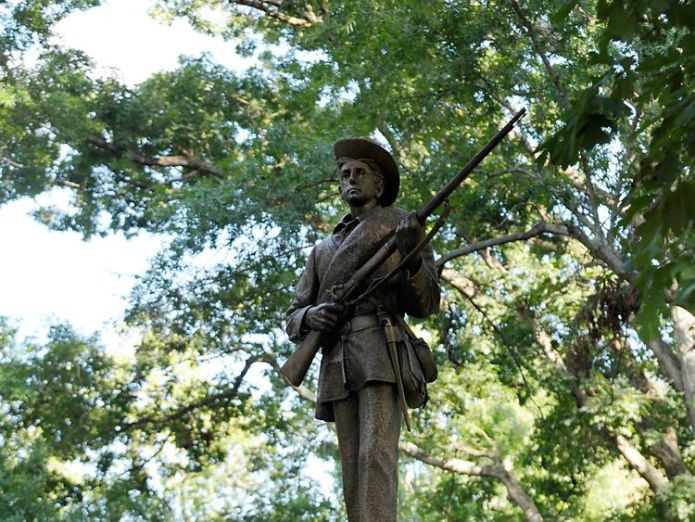 CHAPEL HILL, NC - AUGUST 22: A Confederate statue, coined Silent Sam, is guarded by two layers of fence, chain and police on the campus of the University of Chapel Hill on August 22, 2017 in Chapel Hill North Carolina. Demonstrators rallied for its removal. (Photo by Sara D. Davis/Getty Images)  Students tear down 'Silent Sam' Confederate statue in North Carolina skynews silent sam statue 4396742