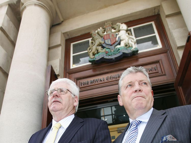 Stanley McComb (R) stood with another victim's relative Michael Gallagher (L) during a civil case against five accused men