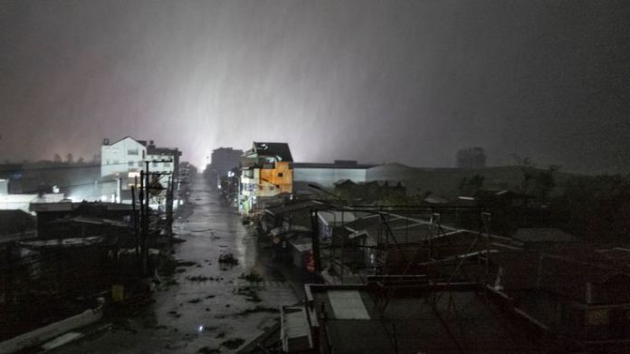 Rains cover the city as strong winds batter houses and buildings lying on the path of Typhoon Mangkhut as it makes landfall on September 15, 2018 in Tuguegarao city, northern Philippines  Typhoon Mangkhut: Storm's path of destruction skynews tuguegarao mangkhut 4421131