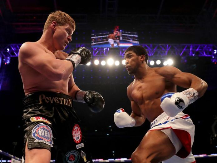 Anthony Joshua and Alexander Povetkin in action at Wembley  Anthony Joshua retains heavyweight titles with win over Alexander Povetkin anthony joshua povetkin wembley 4430460