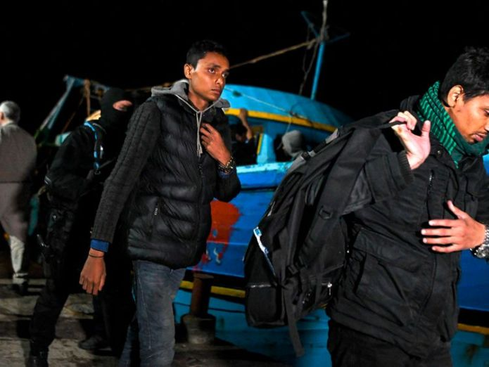Migrants rescued from their boat in May off the coast of Crete  British and Greek police smash Crete trafficking gang skynews crete migrants 4412722