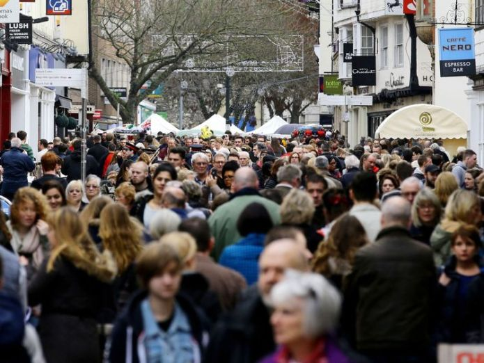 Canterbury High Street in Kent  Government's 100,000 net migration cap 'not policy', Migration Advisory Committee chair says skynews high street shoppers 4424949