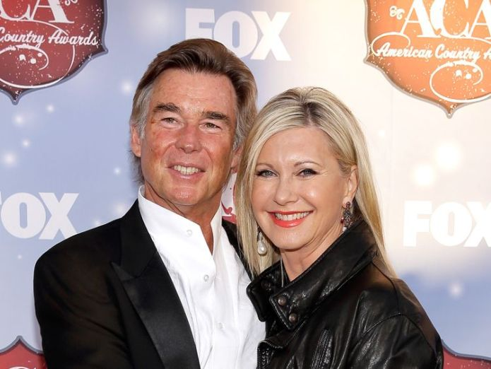 John Easterling and actress Olivia Newton-John arrive at the American Country Awards 2013 at the Mandalay Bay Events Center on December 10, 2013 in Las Vegas, Nevada  Olivia Newton-John treating third cancer 'naturally' and using cannabis oil to control pain skynews john easterling olivia newton john 4416964