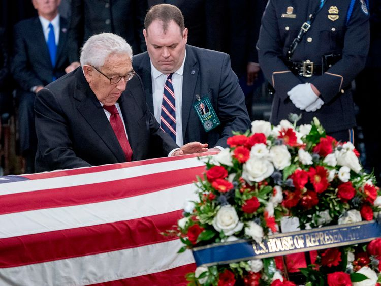 WASHINGTON, DC - AUGUST 31: Former Secretary of State Henry Kissinger touches the casket of Sen. John McCain, R-Ariz., as he lies in state in the Rotunda of the U.S. Capitol, on August 31, 2018 in Washington, DC. The late senator died August 25 at the age of 81 after a long battle with brain cancer. He will lie in state at the U.S. Capitol, a rare honor bestowed on only 31 people in the past 166 years. Sen. McCain will be buried at his final resting place at the U.S. Naval Academy. (Photo by And