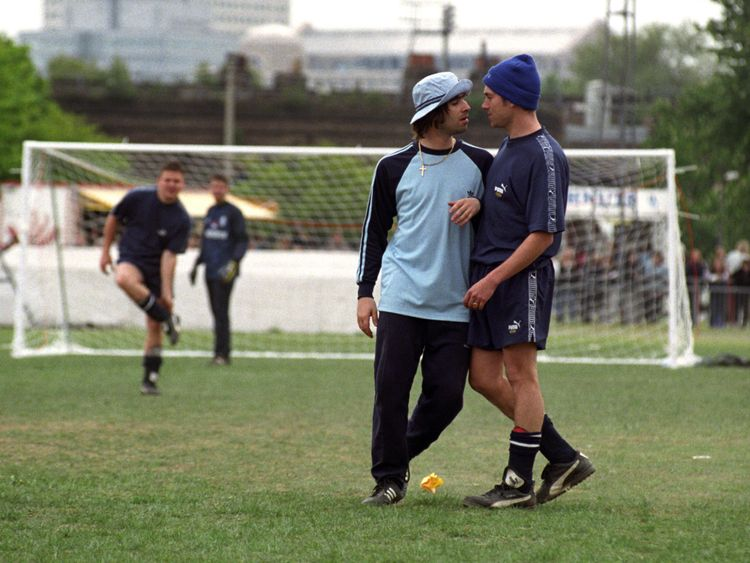 Liam Gallagher of Oasis and Damon Albarn of Blur pictured during a celebrity football match in the mid-1990s