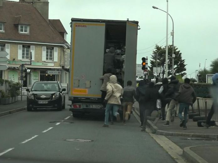 Ouistreham  Migrants' desperate dash to catch lorries to the UK skynews ouistreham migrants 4413430