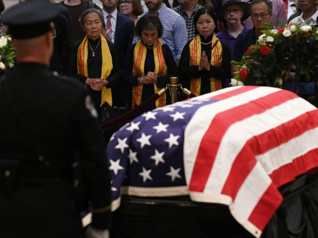 Mourners file past the casket of Senator McCain who lies in state in the Rotunda at the U.S. Capitol...