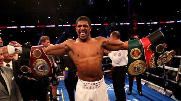 Joshua held on to all three of his titles