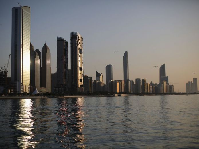 A general view of the city skyline at sunset from Dhow Harbour on February 5, 2015 in Abu Dhabi, United Arab Emirates  British student held in UAE on 'spying charges' skynews abu dhabi uae 4449551