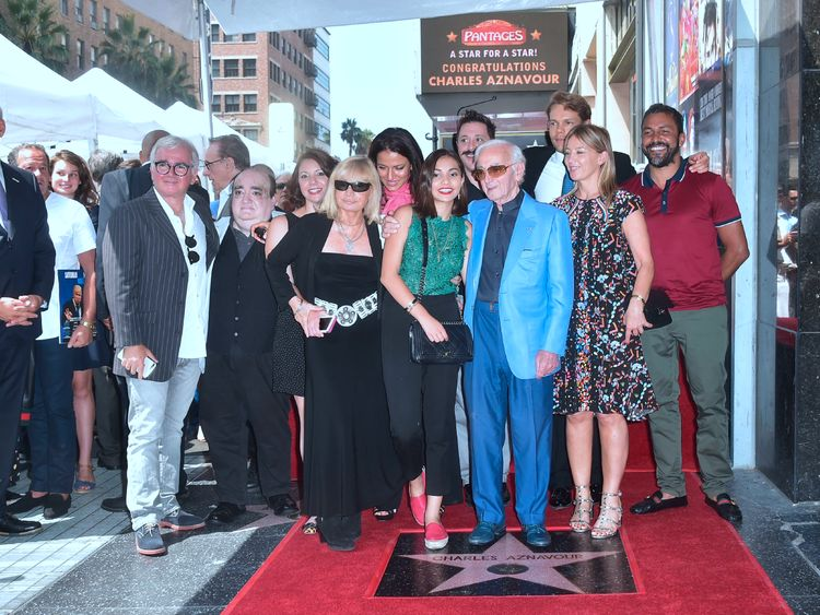 Singer Charles Aznavour poses with his family on his Hollywood Walk of Fame Star in Hollywood
