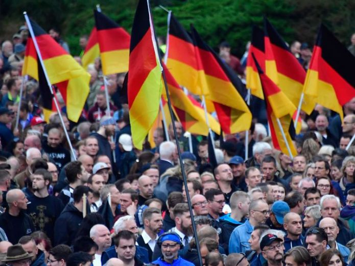 Demonstrators hold flags of Germany during a protest organised by the right-wing populist 'Pro Chemnitz' movement, the far-right Alternative for Germany (AfD) party and the anti-Islam Pegida movement, on September 1, 2018 in Chemnitz, eastern Germany  Populist politics and the far right in Germany skynews chemnitz germany far right 4449480