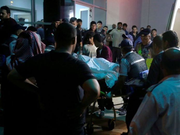 Residents and relatives of flood victims gather outside a hospital near the Dead Sea in Jordan October 25, 2018  Flash flooding hits historic Jordan city of Petra two weeks after school children die skynews jordan dead sea flood 4464871