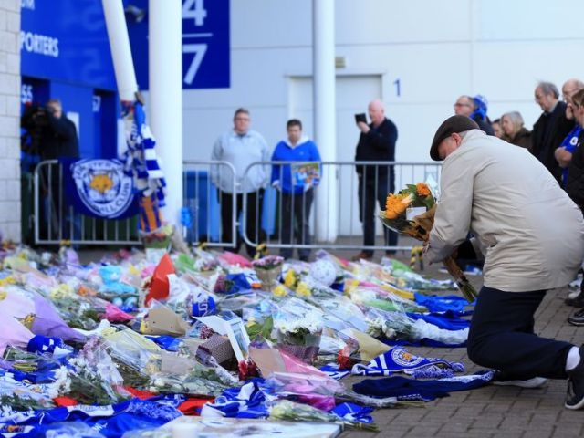 Fan have left flowers and mementos at the club after the crash