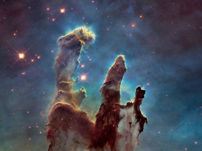 NASA's Hubble Space Telescope has revisited the famous Pillars of Creation, originally photographed in 1995, revealing a sharper and wider view of the structures in this visible-light image.  NASA staff working 24/7 to deal with Hubble space telescope issues skynews nasa pillars of creation 4447273
