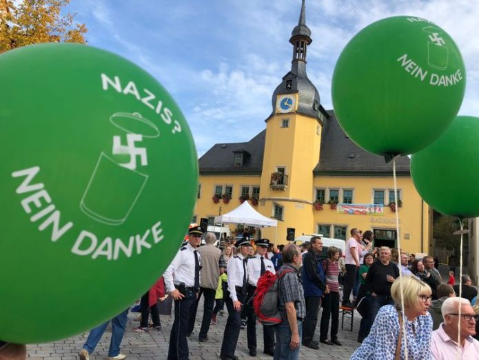 Protesters carrying balloons saying 'Nazis, no thank you' is seen demonstrating against a neo-nazi rock concert in Apolda  Police injured in violence at neo-Nazi rock concert in German town skynews neo nazism apolda 4446028