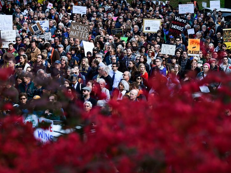 People protesting against US President Donald Trump gather near the Tree of Life Congregation on October 30, 2018 in Pittsburgh, Pennsylvania
