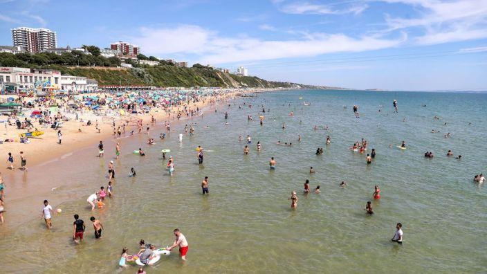 People enjoying the heatwave on Bournemouth beach