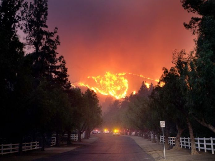 The Woolsey Fire burns towards Paramount Ranch in Agoura Hills, California  At least five people killed in their cars as California wildfires spread and Malibu is evacuated skynews california wildfires 4482174