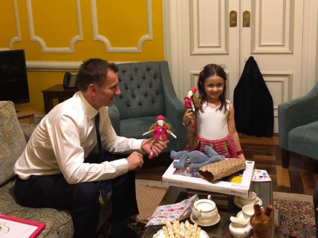 Foreign Secretary Jeremy Hunt meets Gabriella, daughter of jailed British-Iranian Nazanin Zaghari-Ratcliffe. He brought gifts for both of them. Nazanin made dolls for Gabriella and Hunt's own daughter. CREDIT - Pic: @FreeNazanin