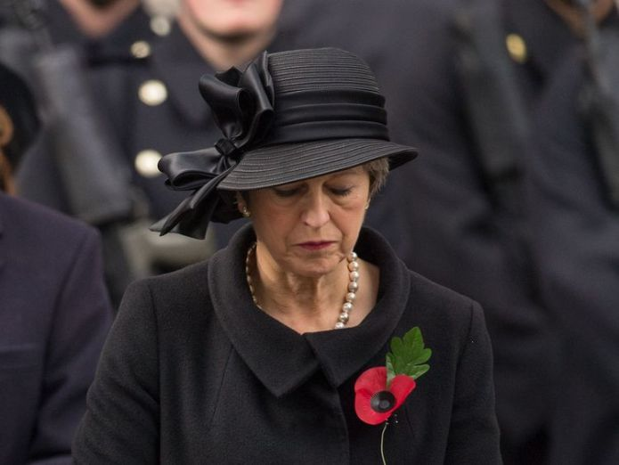 Ms. May, pictured at the Whitehall Commemoration in 2017, will place a wreath next to a German guide