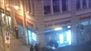 Armed police on the streets of Strasbourg shout at people to stay inside