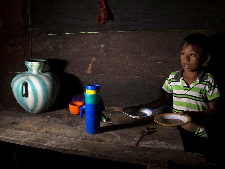 Abdel Caal, brother of Jakelin, a 7-year-old girl who died in U.S. custody, stands inside his house in Raxruha, Guatemala December 15, 2018. REUTERS/Josue Decavele