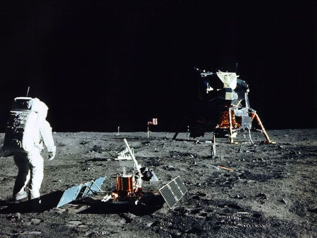 Buzz Aldrin stands on the surface of the moon in 1969