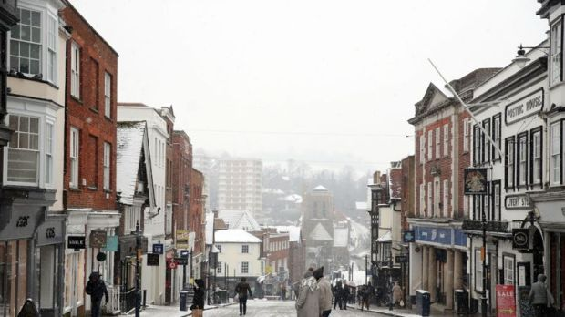 A dusting of snow covers Guildford High Street, as the severe weather conditions continue
