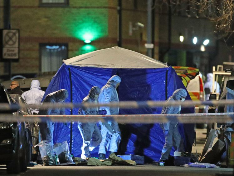 Forensic investigators at the scene in Leyton, Waltham Forest in north-east London where a 14-year-old boy died after he was found with stab injuries