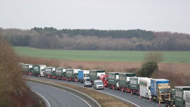 Lorries form up on the A526 outside Dover for the second of two trials at the former Manston Airport site in Kent