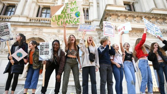 Students from the Youth Strike 4 Climate movement in Whitehall during a climate change protest in Westminster
