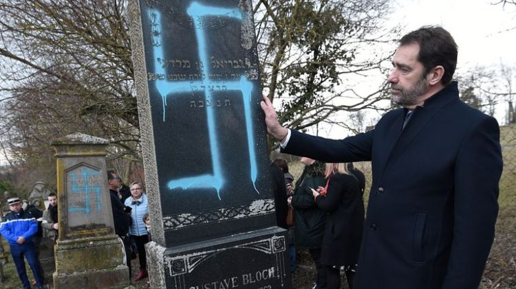Swastikas were painted on about 90 gravestones