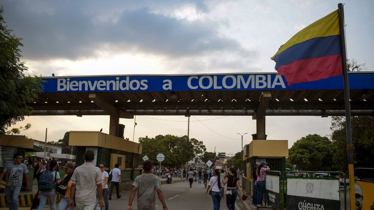 People cross the Simon Bolivar International Bridge on the border between Tachira in Venezuela and Cucuta in Colombia