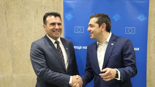 The Republic of North Macedonia's Prime Minister Zoran Zaev, left, agreed to a compromise with the Greek leader Alexis Tsipras, right