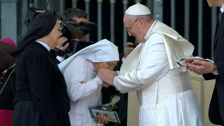 pope accepting kisses at