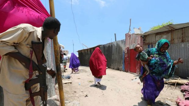 A Somali soldier holds his position as the town is evacuated
