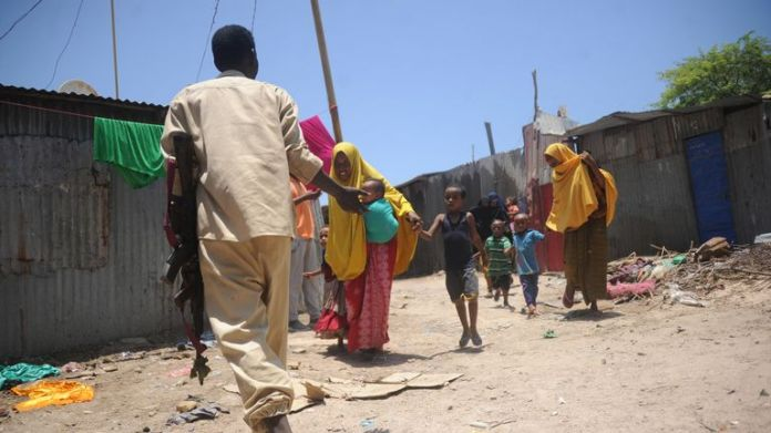 Somali women and children flee the scene after two explosions
