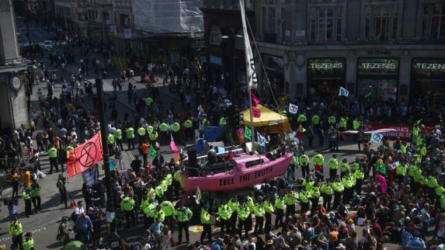 Climate change activists are seen during an Extinction Rebellion protest at Oxford Circus in London, Britain April 19, 2019
