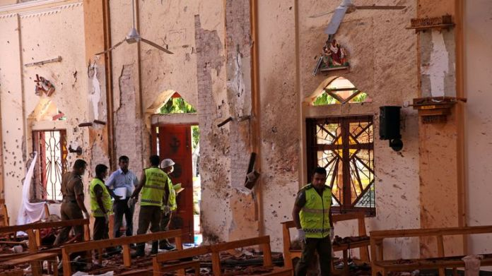 Police officers are working on the scene in the Catholic St. Sebastian Church after bomb attacks by churches and luxury hotels took place on Easter April 22, 2019 in Negombo, Sri Lanka