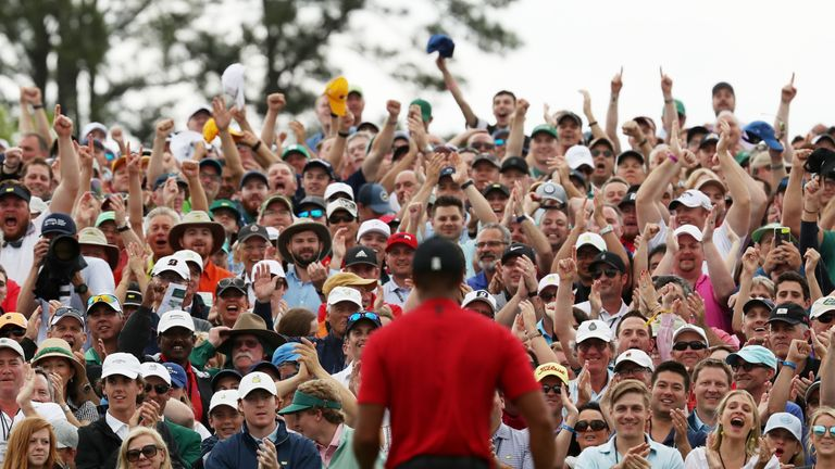 Crowds flocked to watch Woods sink his final putt