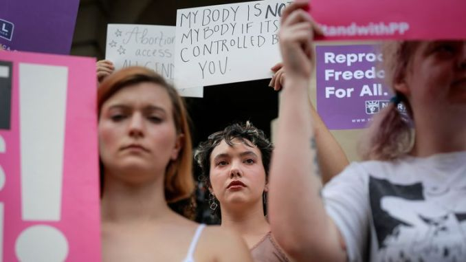 Women protest against Georgia's anti-abortion 'heartbeat' bill