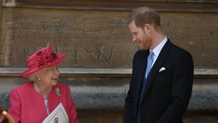 Queen Elizabeth II talks to the Duke of Sussex as they leave after the wedding of Lady Gabriella Windsor