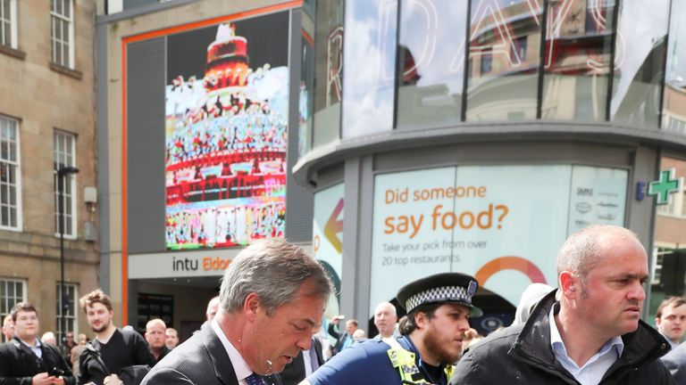 Mr Farage was led away by security quickly