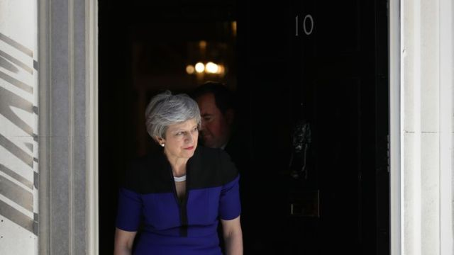 Prime Minister Theresa May leaves to Nato Secretary General Jens Stoltenberg to 10 Downing Street, London. PRESS ASSOCIATION Photo. Picture date: Tuesday May 14, 2019. Photo credit should read: Aaron Chown/PA Wire