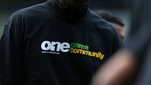 A view of a Kick It Out anti-racism t-shirt worn by a player during pre-match training