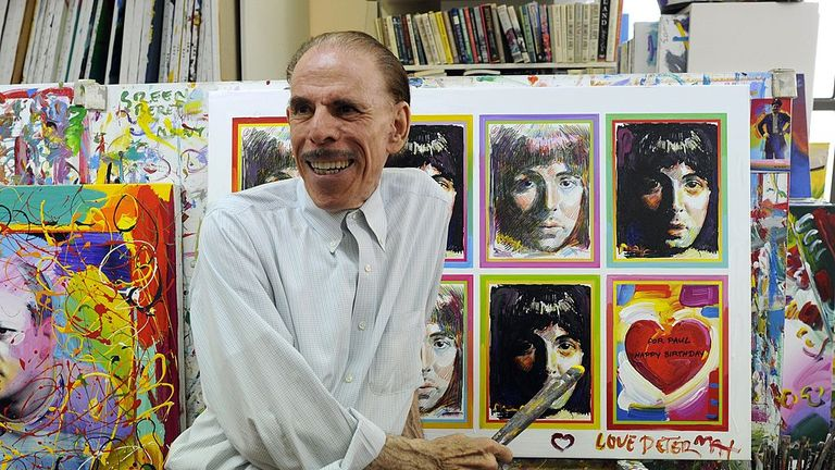 Pop artist Peter Max poses in his New York studio on June 18, 2012 with seven portraits he created of Sir Paul McCartney to commemorate McCartney's 70th birthday. Max's cosmic characters painted against bold, vibrant colors, and cosmic landscapes were among the most influential graphic source of the 1960s.