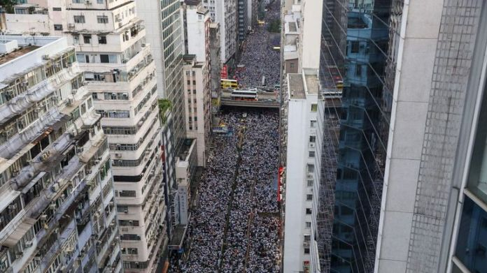 Protesters march during a rally against a controversial extradition bill in Hong Kong