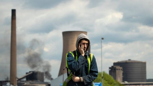 Workers leave the steelworks plant in Scunthorpe